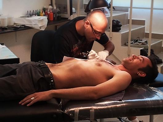 Aviv Rotshas tattooing